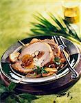 Roast pork stuffed with apricots and hazelnuts