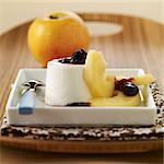 Curdled ewe's milk dessert with stewed apples and black cherry jam
