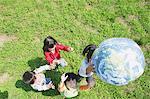 Children Holding Inflatable Globe