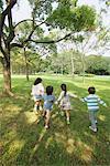 Children Walking In Park Together