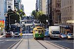 Australia, Victoria, Melbourne.  A tram trundles along the streets of downtown Melbourne.