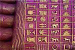 Myanmar, Burma, Yangon, Rangoon.  The Reclining Buddha, Chaukhtatgyi Paya, in Yangon has 108 sacred symbols on the soles of his feet.  Each mark describes the life of Buddha before attaining enlightenment.