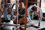 Myanmar, Burma, Inle Lake.  Spinning silk in a weaving factory, Inle Lake.