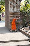 Thailand, Chiang Mai, Wat Lok Moli temple, young monk playing with a water gun