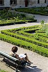 France, Paris, hotel de Sens, woman on a bench