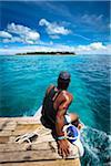 Man on Boat to Fafa Island Resort, Nuku'alofa, Tongatapu, Kingdom of Tonga