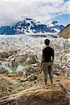 Teenager at Salmon Glacier, Coast Mountains, north of Stewart, British Columbia, Canada