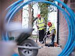 Builders installing water pipes