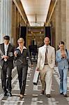 Business people walking down a corridor