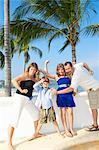 family posing as superheroes