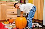 boy carving jack o'lantern