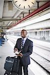 A businessman with a calendar at a train station, Stockholm, Sweden.