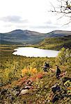Sportsmen in a mountain scenery, Sweden.