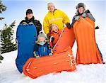 Family outdoor enjoying winter day sledding