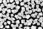 A large group of transparent computer keys scattered on a black background, digital composite