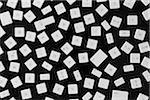 A large group of computer keys scattered on a black background