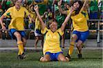 Brazilian female soccer players celebrating goal