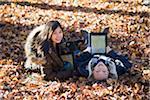 Girls using iPads in Autumn