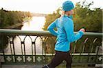 Woman Jogging across Bridge, Seattle, Washington, USA