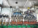 Wine bottles in bottling machine