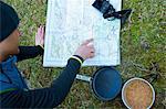 Man examining trail map while camping