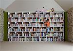 Children climbing bookshelves