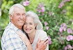 Senior couple hugging in garden