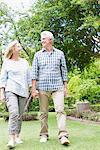 Senior couple walking in garden