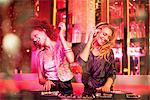 Female DJs in nightclub