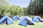 Kids in tents near lake