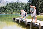 Family fishing off dock