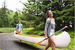 Couple Carrying Canoe, Columbia River Gorge, Oregon, USA