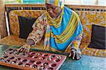 Woman Playing Bao, Zanzibar, Tanzania, Africa