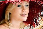 Portrait of a woman wearing a red hat, Sweden.