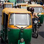Busy road with Tuk-tuk auto rickshaws, Chandni Chowk, Old Delhi, India, Asia