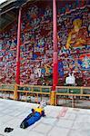Pilgrims praying before the Blue Buddha in central Lhasa, Tibet, China, Asia