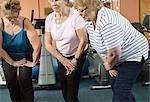 Older women stretching in gym