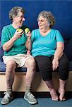 Older couple eating apples together