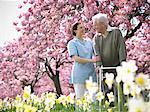 Older man with caretaker in park