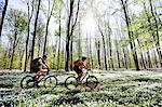 Couple mountain biking together