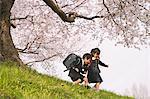 Elementary Schoolchildren Playing In Meadow