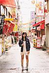 Japanese Women Posing In Chinatown Street