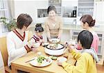 Parents and kids sitting around yosenabe