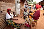 Burundi. Local women shell peanuts at the local market.