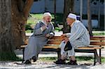 Two friends talking in a garden. Tanger, Morocco
