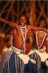 Kigali, Rwanda. A Intore dancer entertains at FESPAD Pan African dance festival.