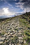 Man trekking along an ancient roman road. Sierra de Gata, Spain