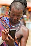 Masai Man in Traditional Dress Using Cell Phone, Zanzibar, Tanzania