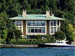 Luxurious coast villa with beautiful motor yacht
