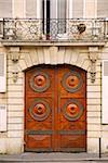 Wooden doors in old building in Paris France